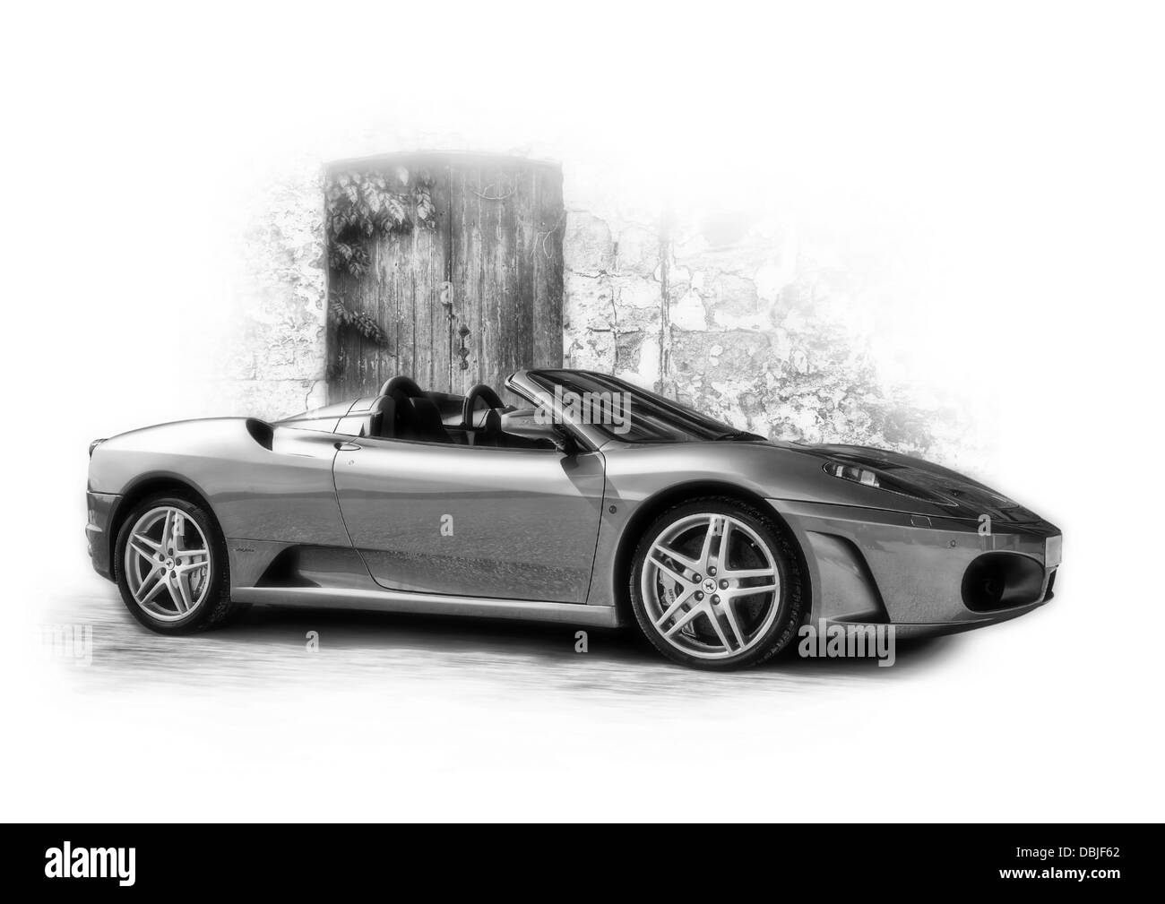 Ferrari F430 photographed on the street and then edited in Photoshop to create the final image. - Stock Image