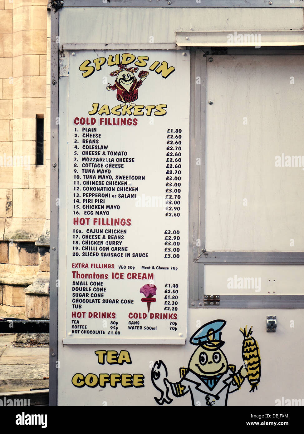Fast food menu on a concession food stall down a York side street, UK. - Stock Image