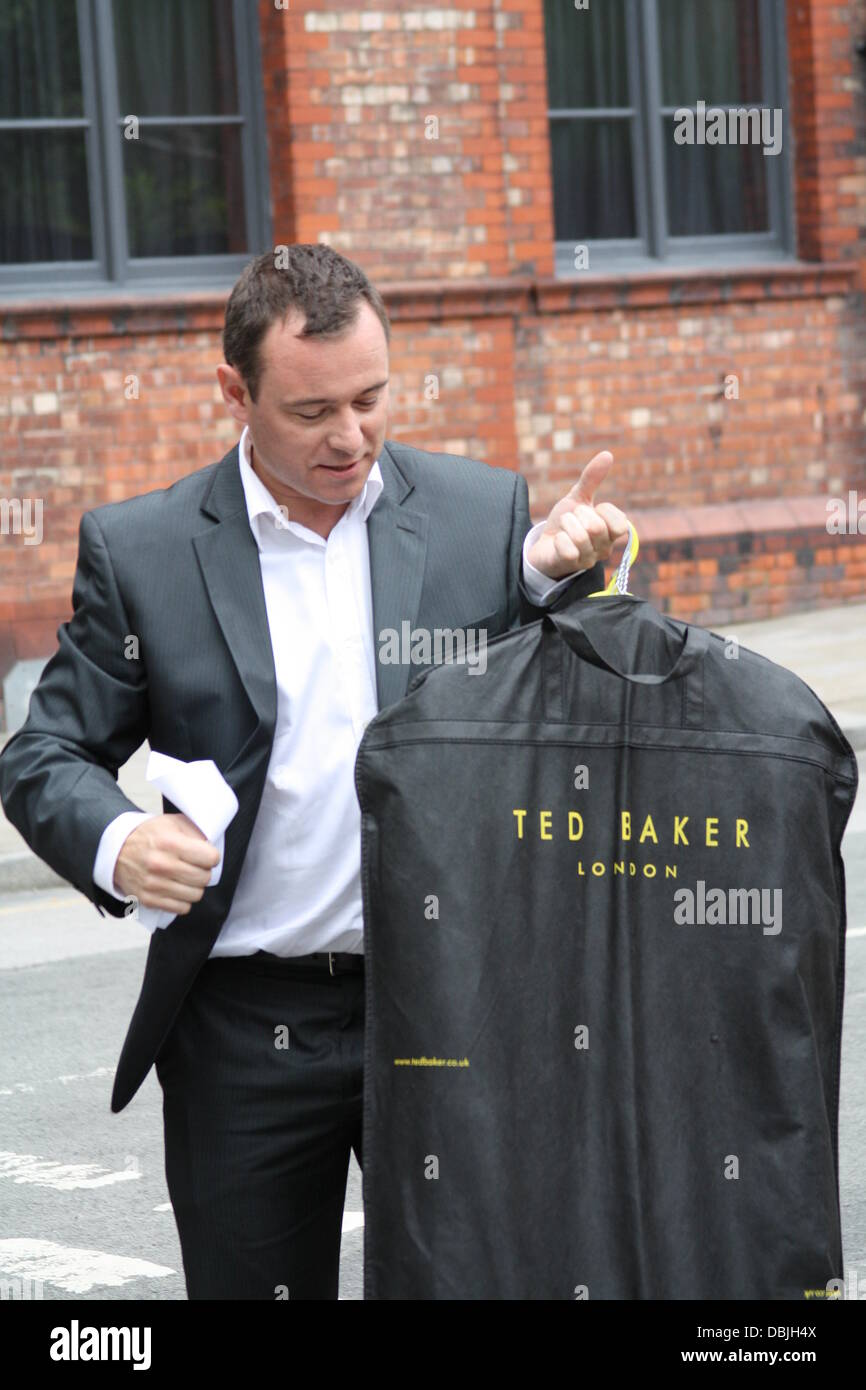 d46e36676aaf7 Andrew Lancel with a Ted Baker suit carrier  Coronation Street  stars  arriving at the