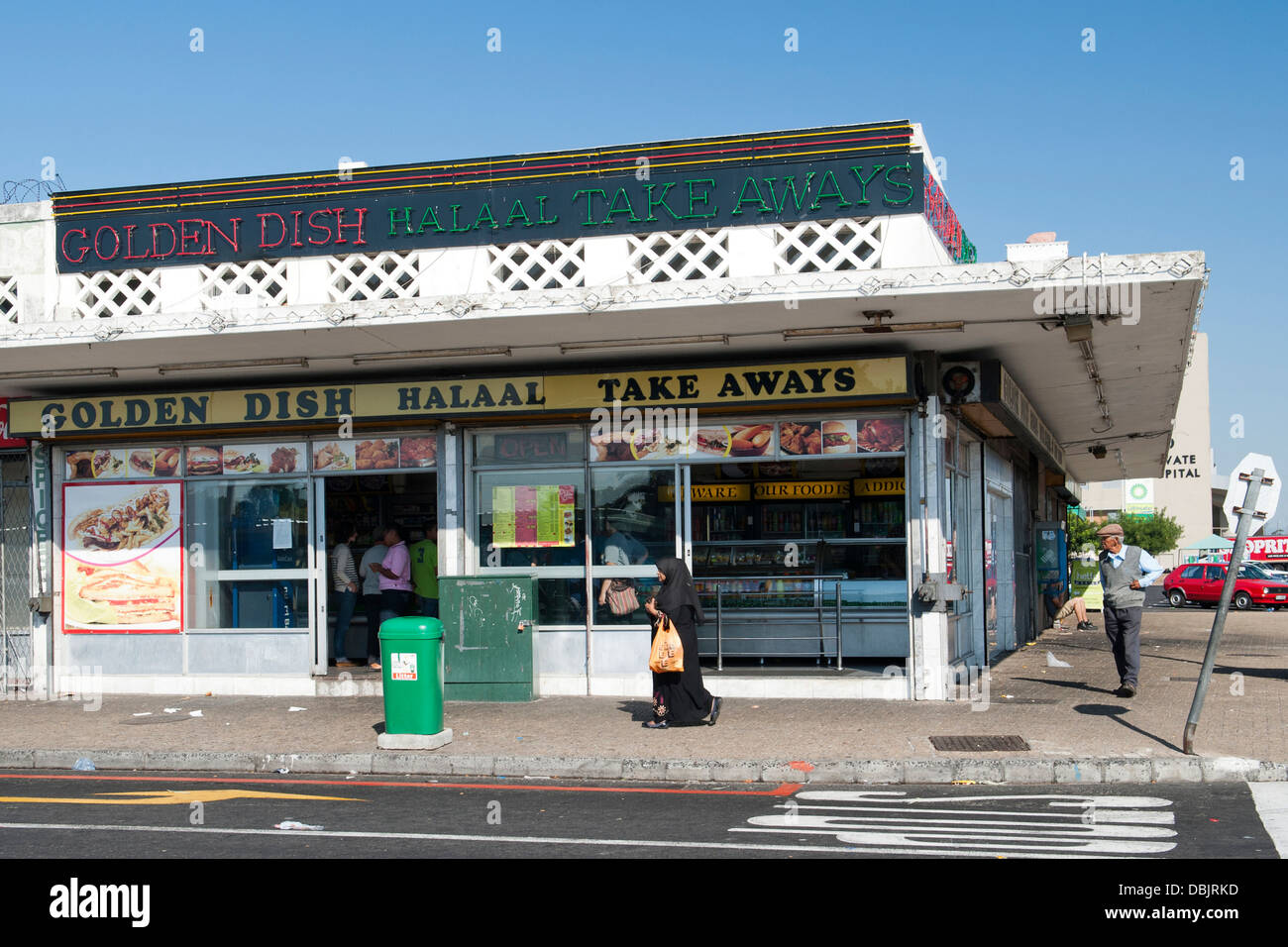 Exterior of the Golden Dish take-away in Athlone, Cape Town, South Africa. - Stock Image