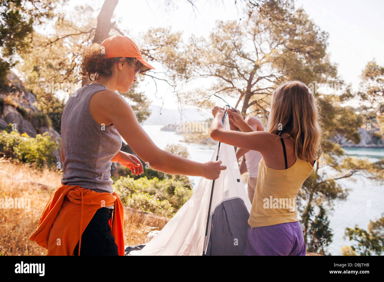 Croatia, Dalmatia, Family holidays on camping site, pitching the tent - Stock Image