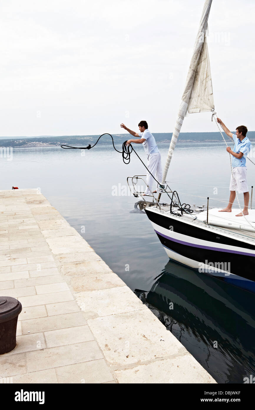Croatia, Sailboat entering port, docking maneuver - Stock Image
