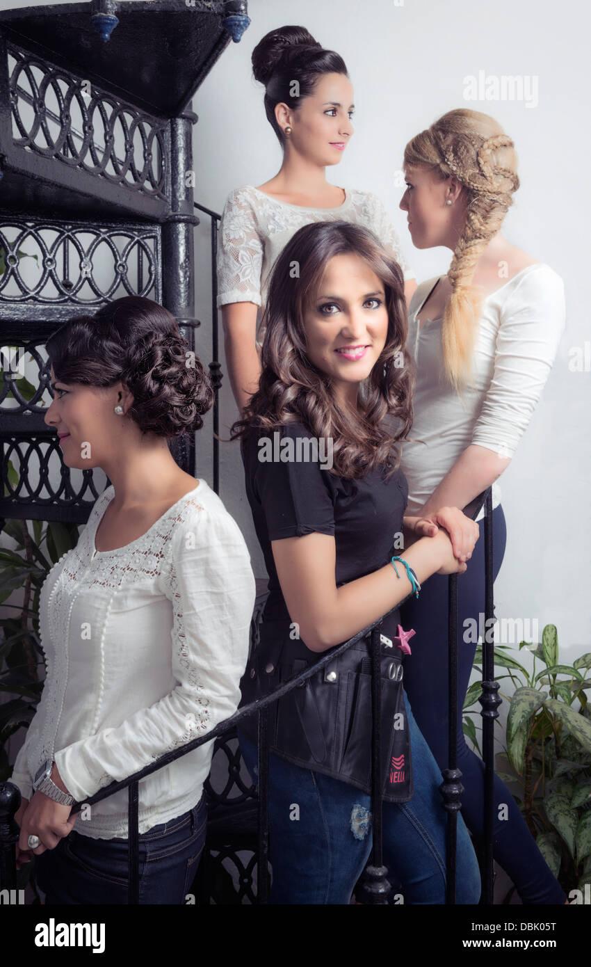 Hairdresser and models. - Stock Image