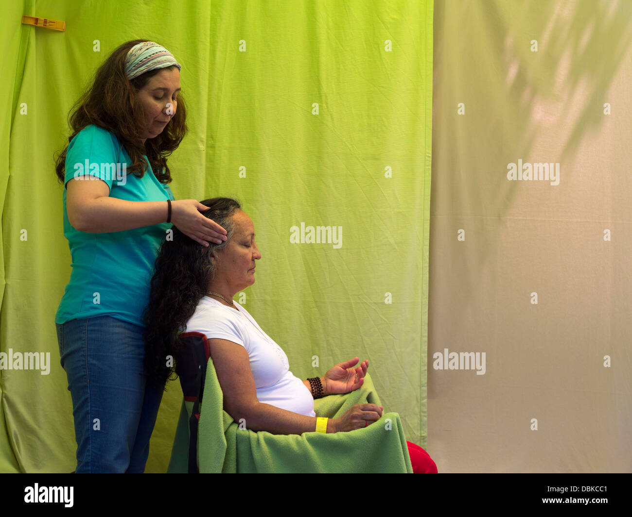 Middle-aged woman getting an indian head massage - Stock Image