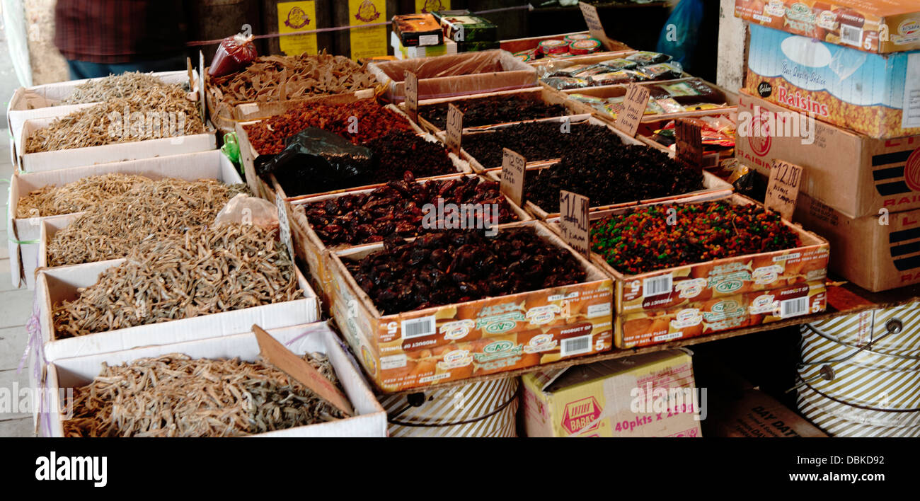 Kuching market with spices and anchovies with fruits on sale in boxes Sarawak Malaysia - Stock Image