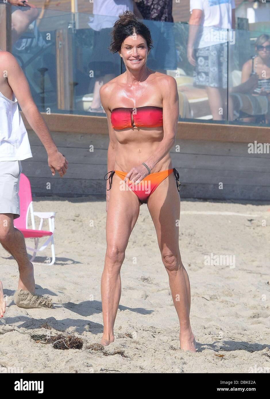 Janice Dickinson celebrating the 4th July Independence Day on the beach in Malibu  Malibu, California- 04.07.11 - Stock Image