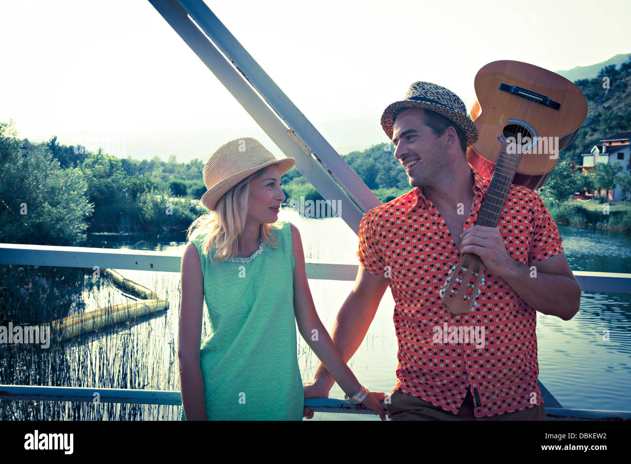 Croatia, Dalmatia, Young couple on a footbridge, man with guitar - Stock Image