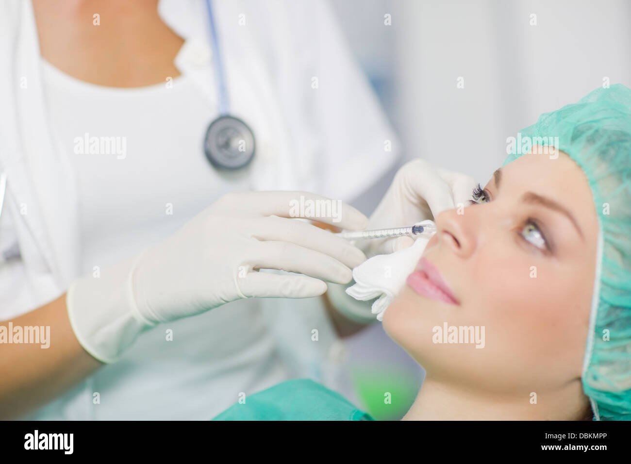 Woman Getting A Botox Injection On Her Face - Stock Image