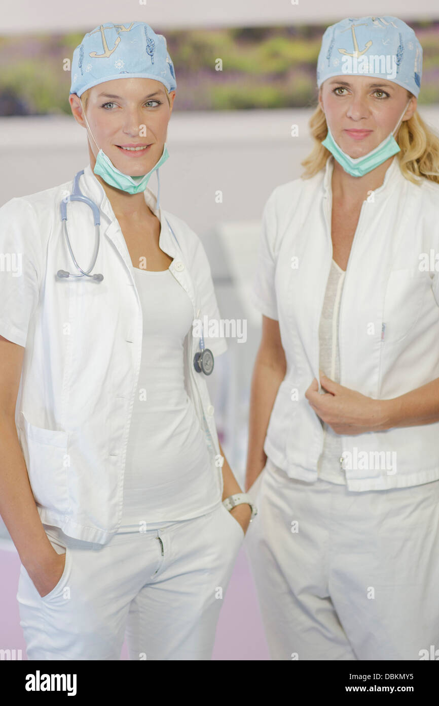 Doctor and Nurse Wearing Surgical Masks - Stock Image