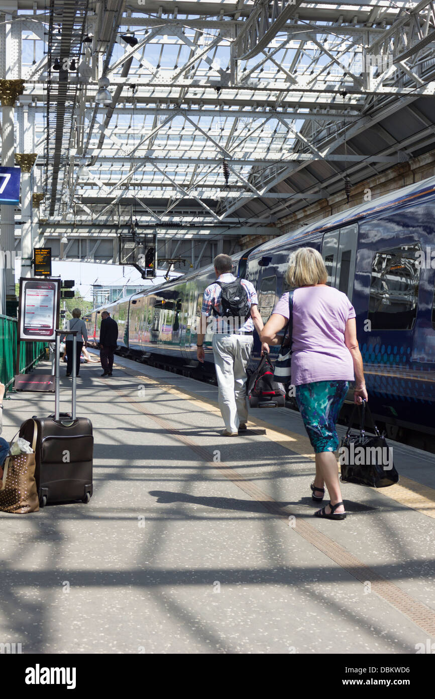 First Scotrail train standing at the platform in Waverley Station in Edinburgh - Stock Image