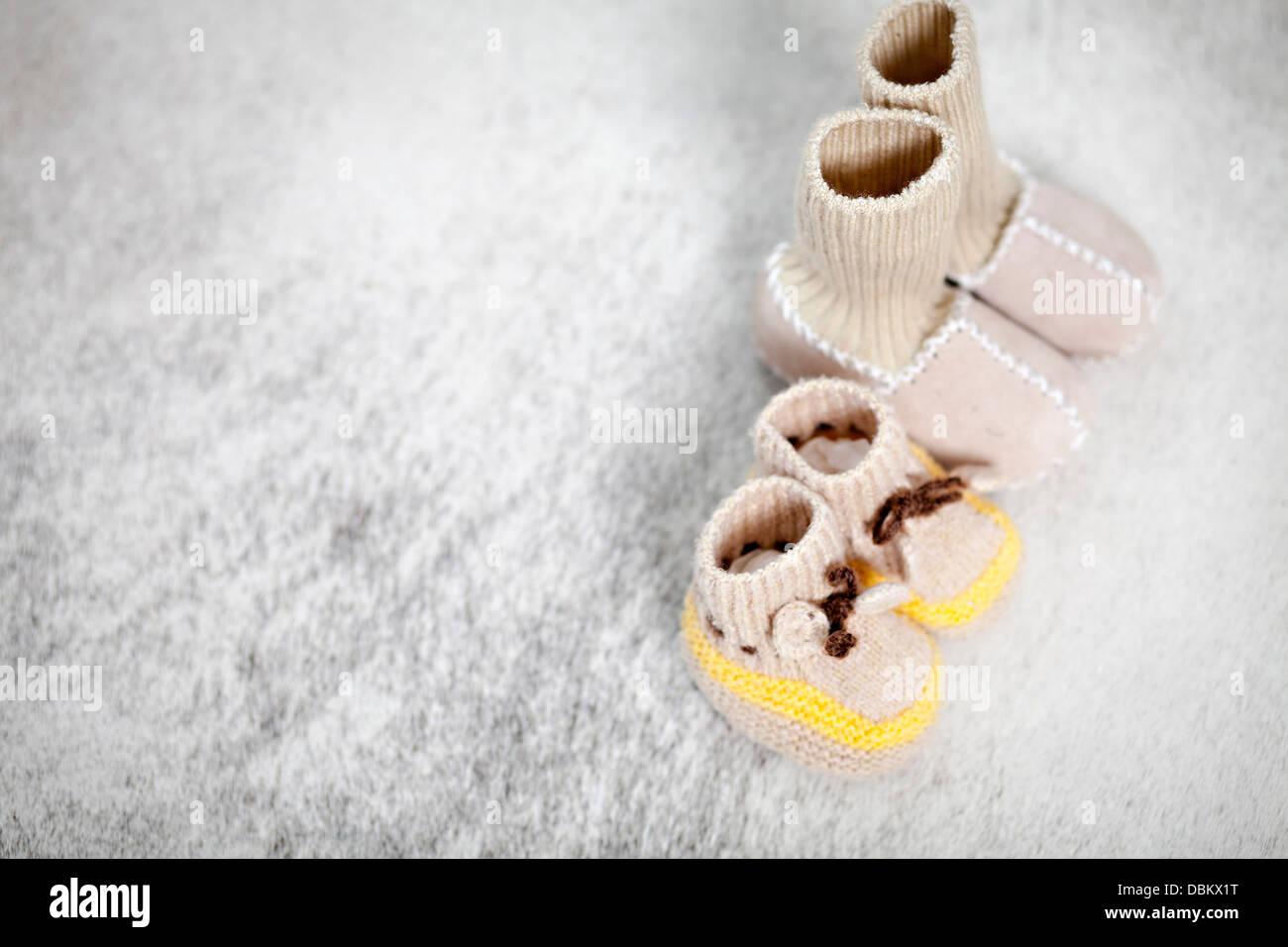 Baby Booties Beside Slipper Socks, Munich, Bavaria, Germany - Stock Image