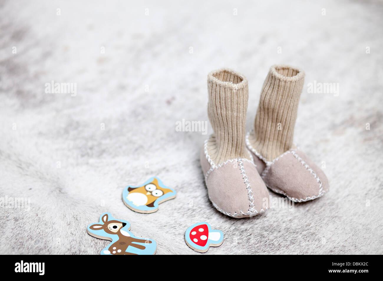 Slipper Socks And Toys, Munich, Bavaria, Germany - Stock Image