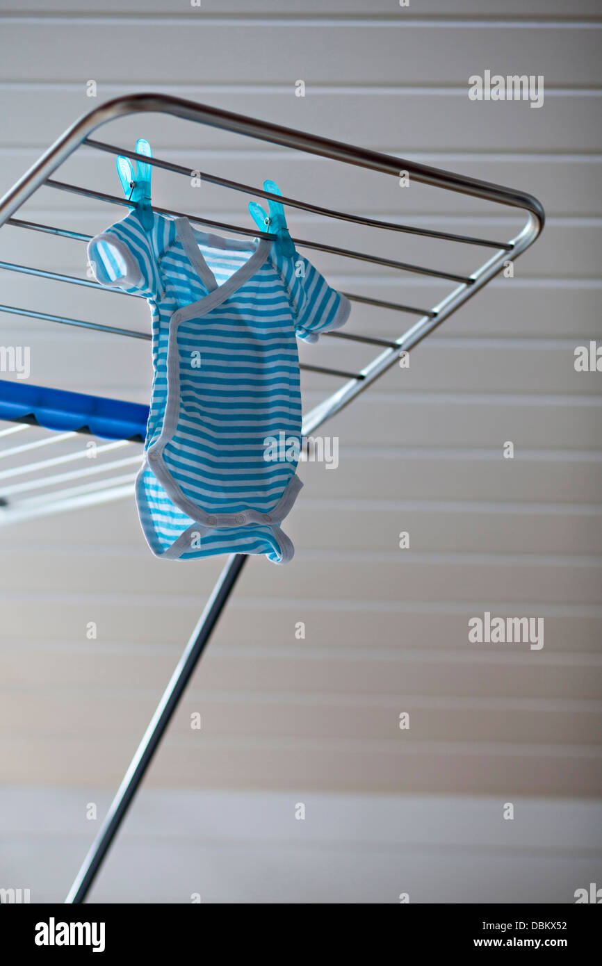 Baby Clothes Drying On Clothes Horse, Munich, Bavaria, Germany - Stock Image
