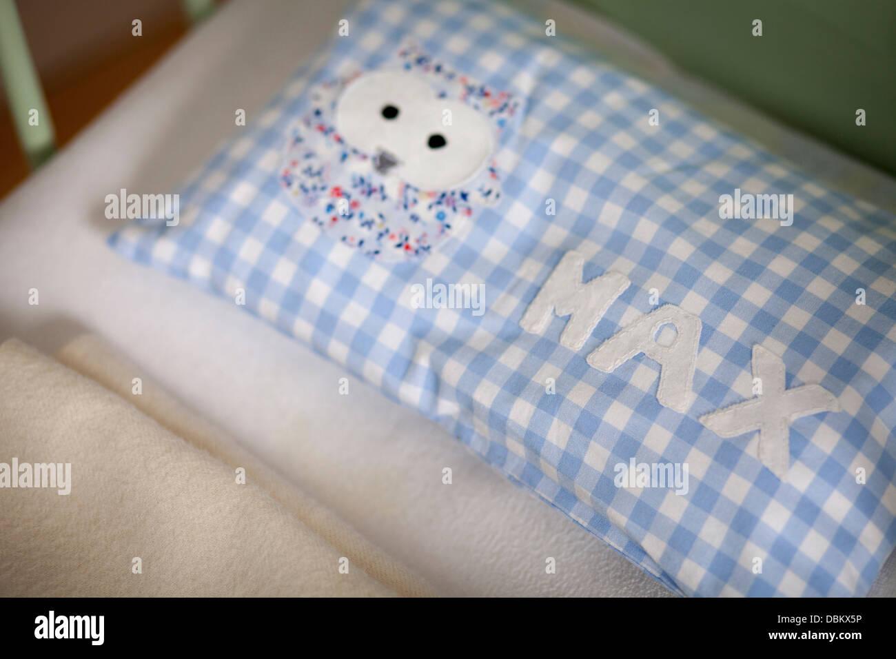 Pillow In Baby Crib, Munich, Bavaria, Germany - Stock Image