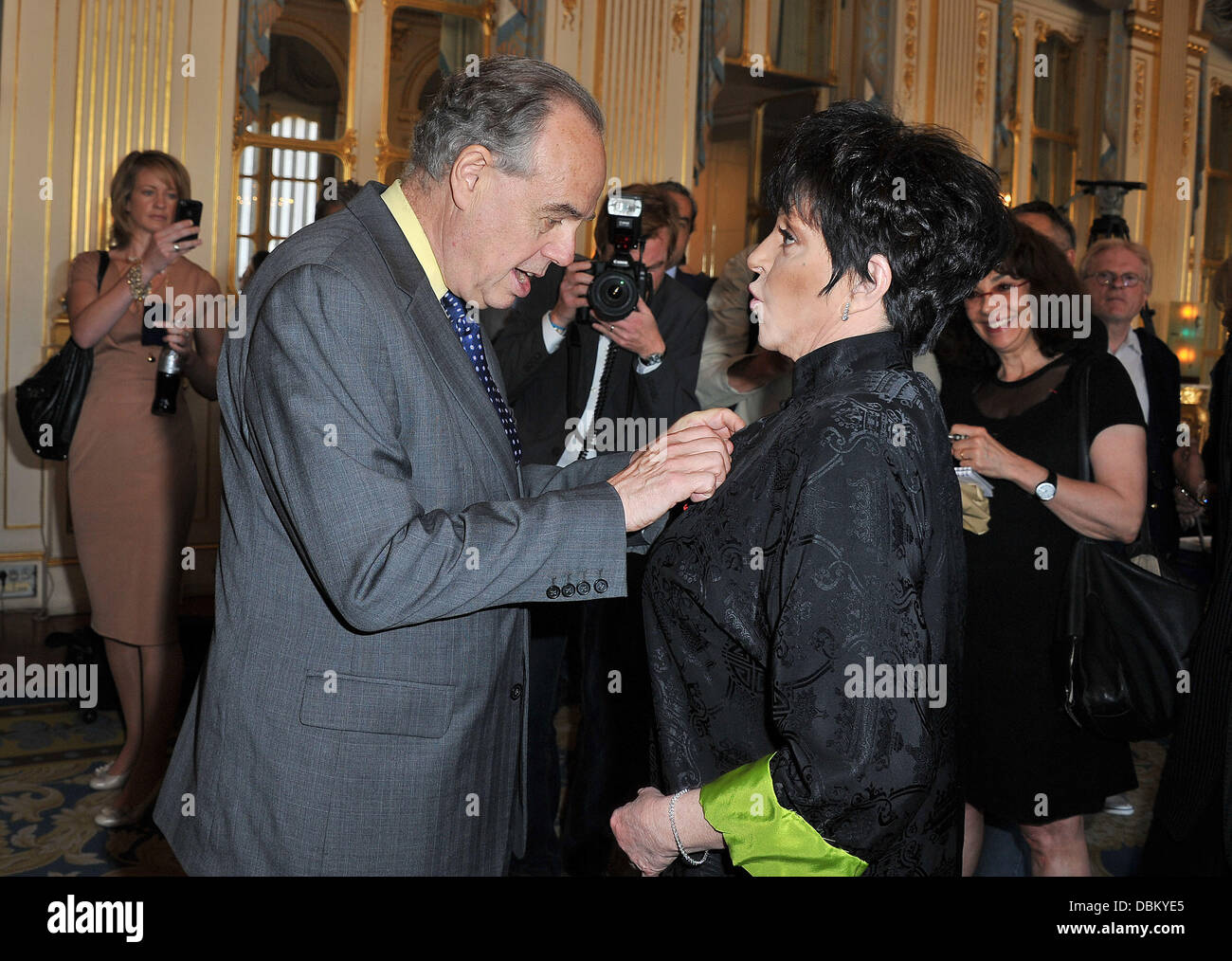 Frederic Mitterrand and Liza Minnelli Liza Minnelli is awarded with chevalier of the Legion of Honour (Chevalier Stock Photo