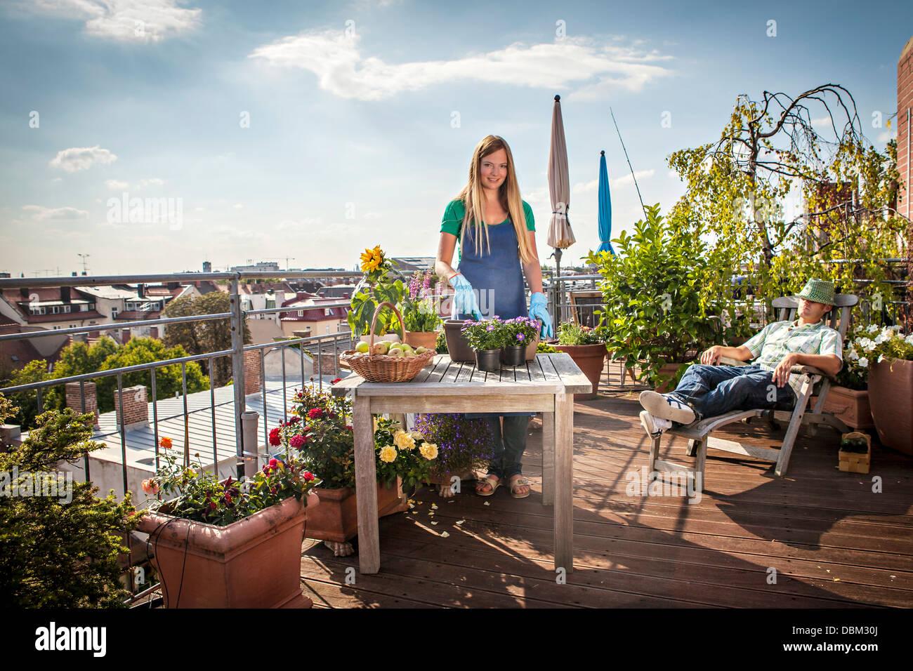 Couple On Roofgarden, Munich, Bavaria, Germany, Europe - Stock Image
