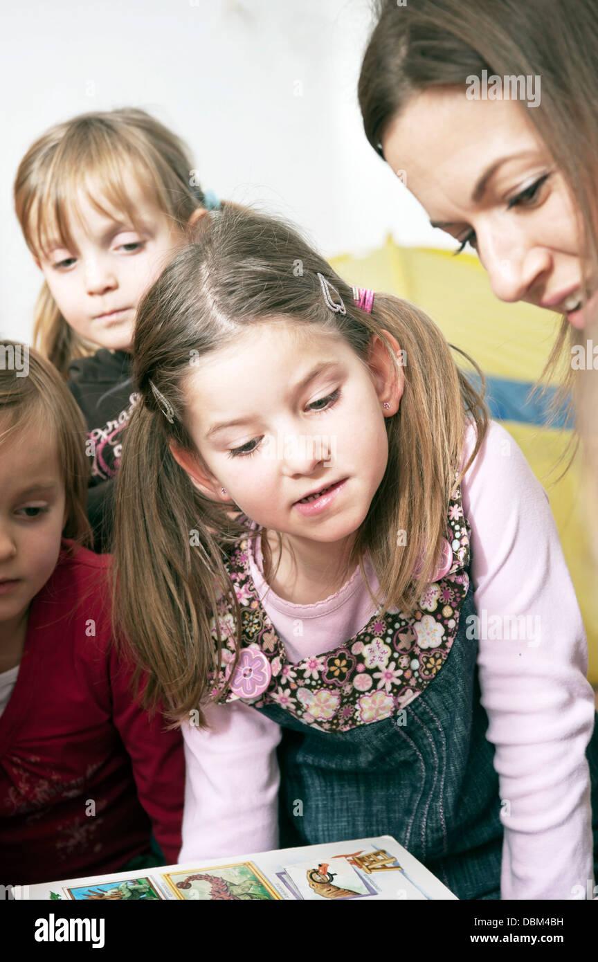 Teacher And Children In Nursery School, Kottgeisering, Bavaria, Germany, Europe - Stock Image