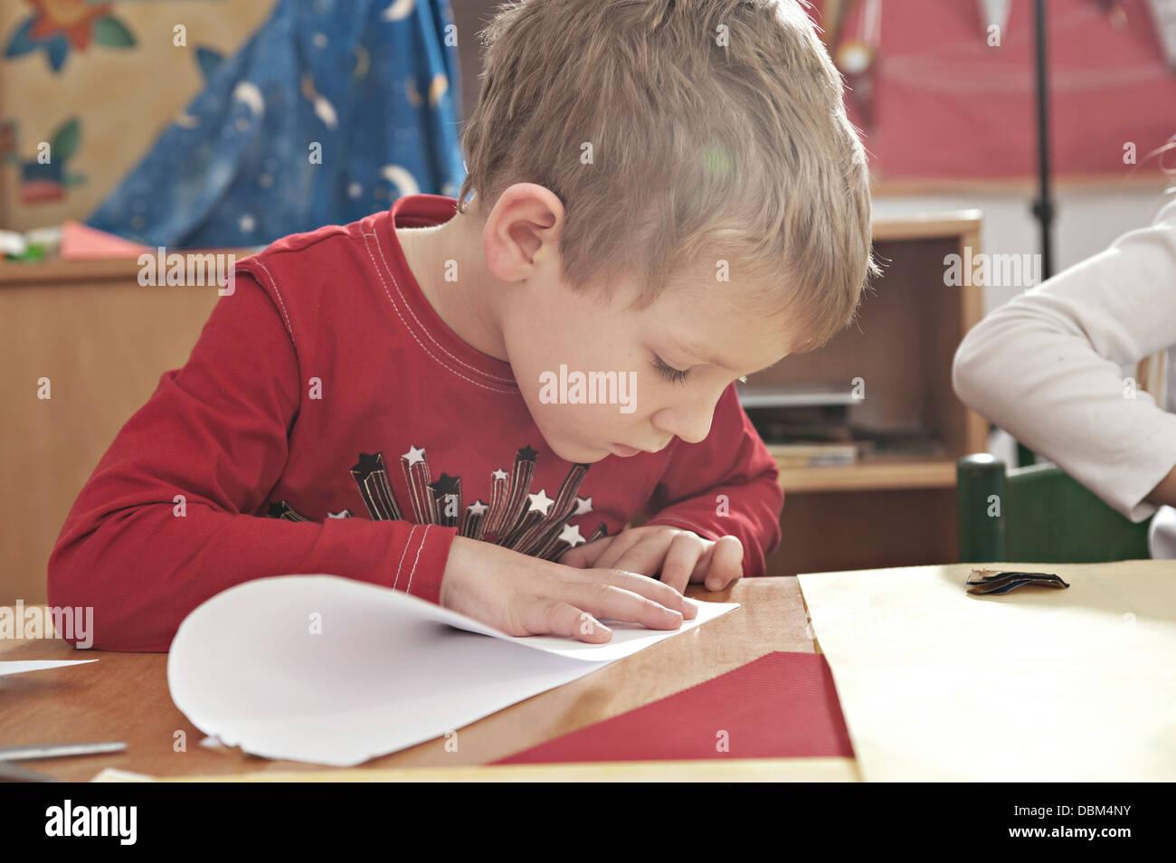 Children In Nursery School Folding Paper Planes, Kottgeisering, Bavaria, Germany, Europe - Stock Image