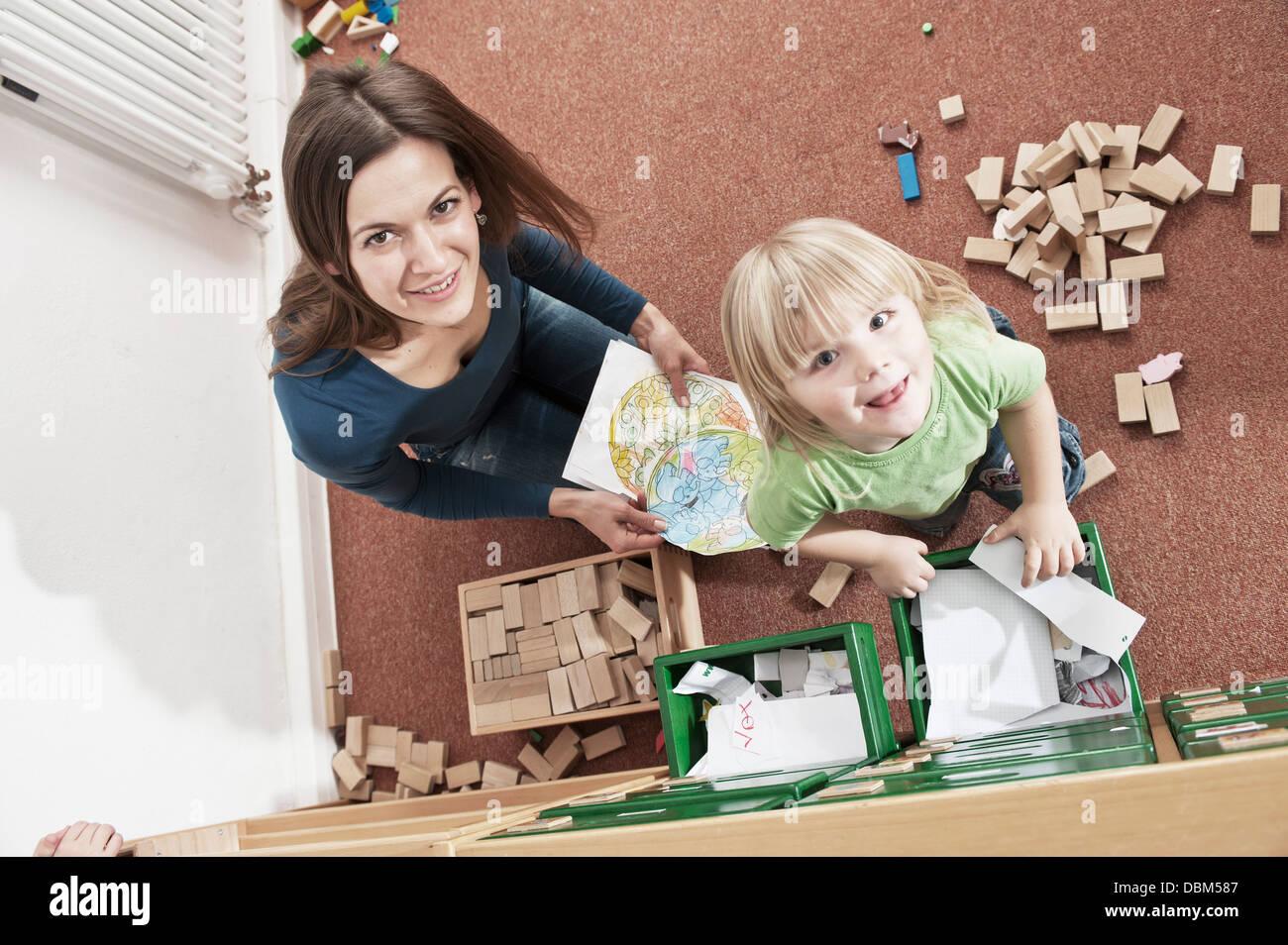 Female Carer And Boy In Nursery School, Kottgeisering, Bavaria, Germany, Europe - Stock Image