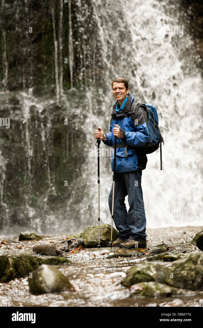 Man Standing In Front Of A Waterfall, Bavaria, Germany, Europe - Stock Image
