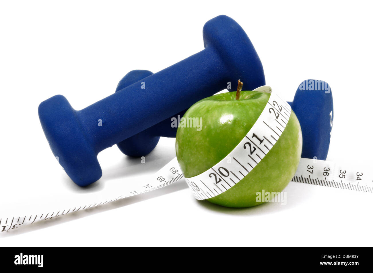 Weights, apple, and tape measure - dieting / healthy living concept - Stock Image