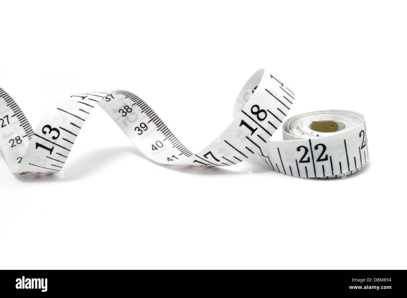 Tape measure isolated on a white background - Stock Image