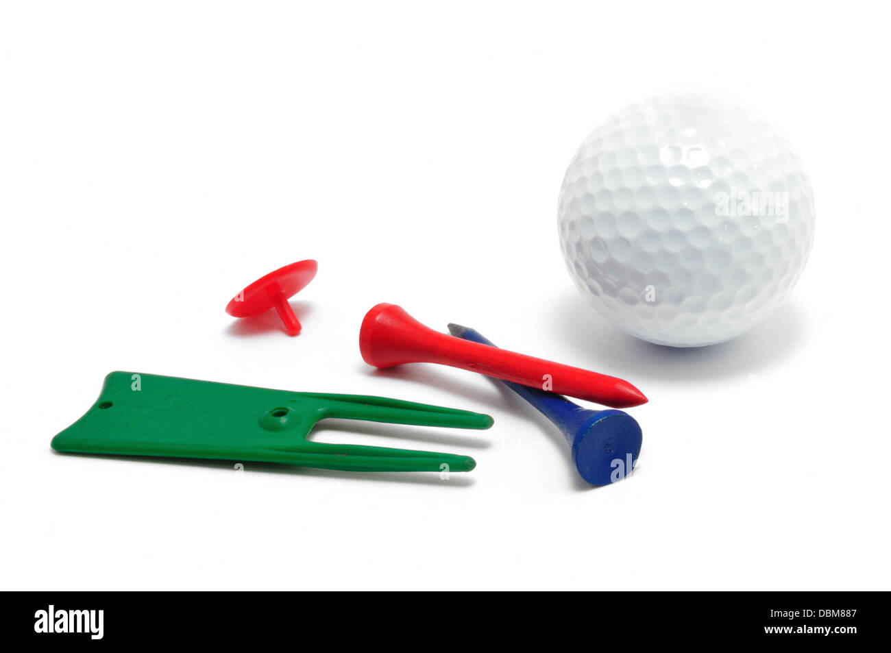 Golf Ball, Tees, Marker, and Divot (Ball Mark) Repair Tool isolated on a white background - Stock Image