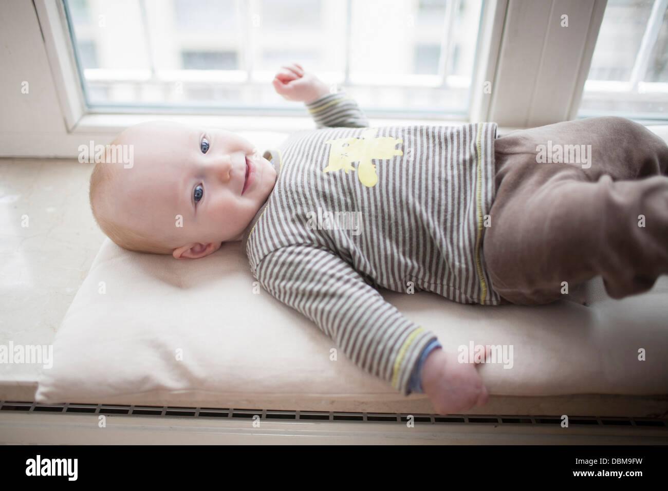 Baby boy lying on back, Munich, Bavaria, Germany - Stock Image