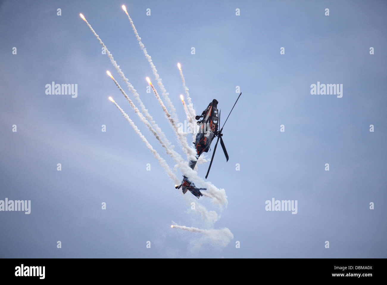 A Royal Netherlands Airforce AH64D Apache attack helicopter demonstrates an evasive manoeuvre - Stock Image