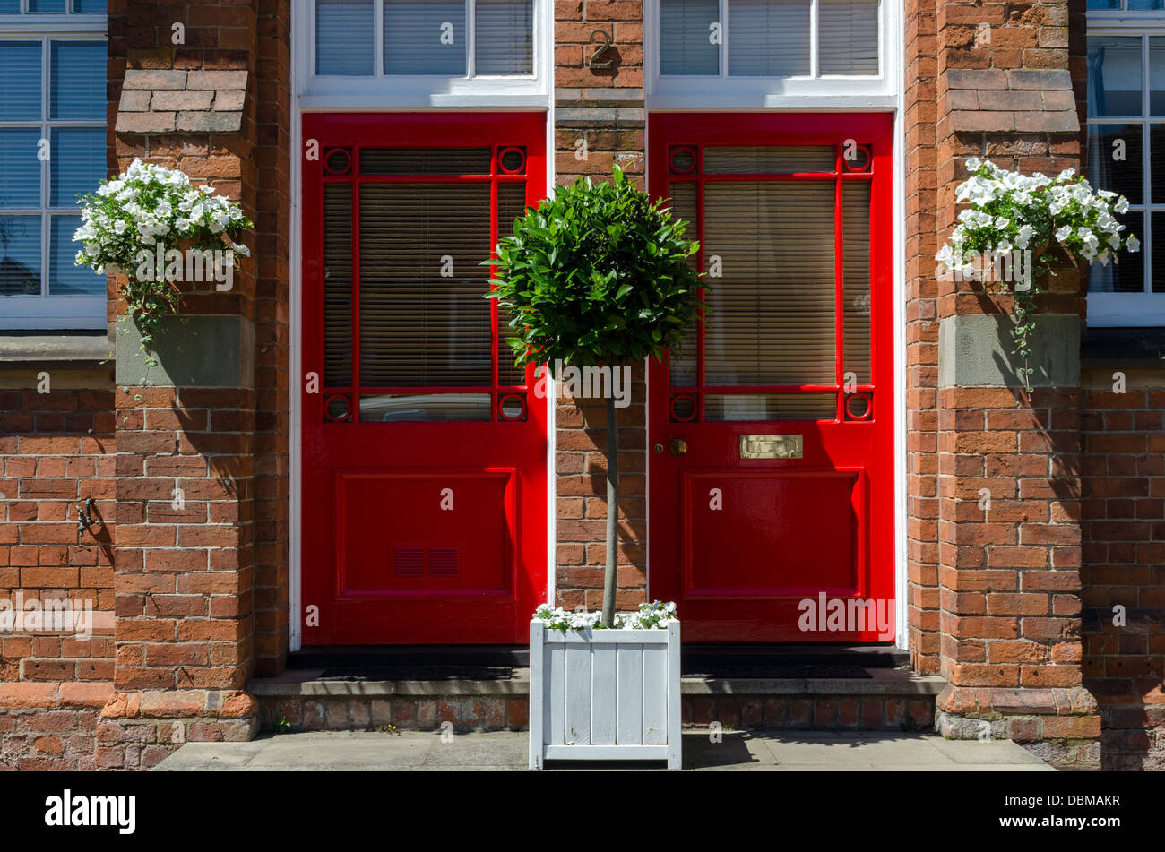 Pair of matching red doors - Stock Image