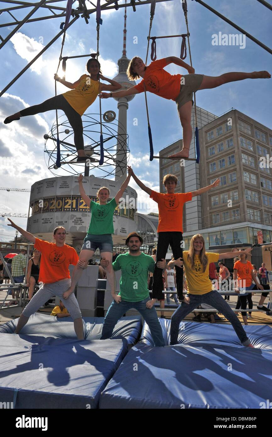Young acrobats show their skills on Alexanderplatz in Berlin, Germany, 01 August 2013. The international street - Stock Image