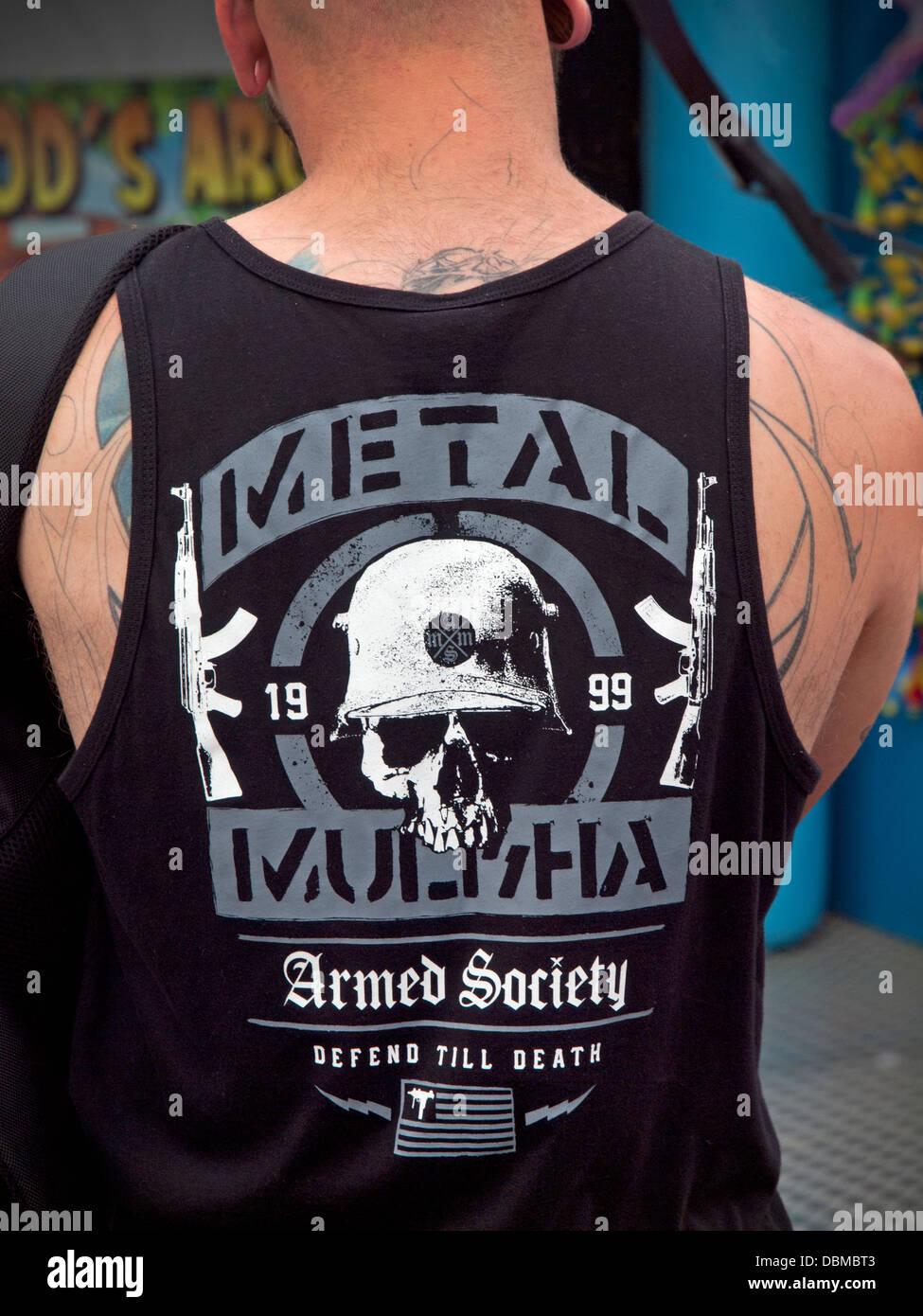 A Metal Mulisha teeshirt worn by a young man - Stock Image