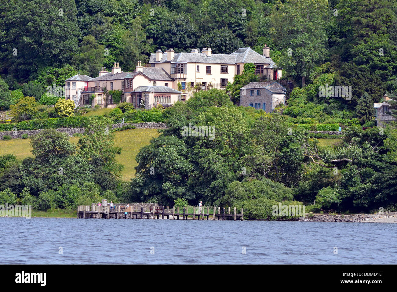 Brantwood, former home of John Ruskin, on the shore of Coniston Water, on the Lake District National park seen from - Stock Image
