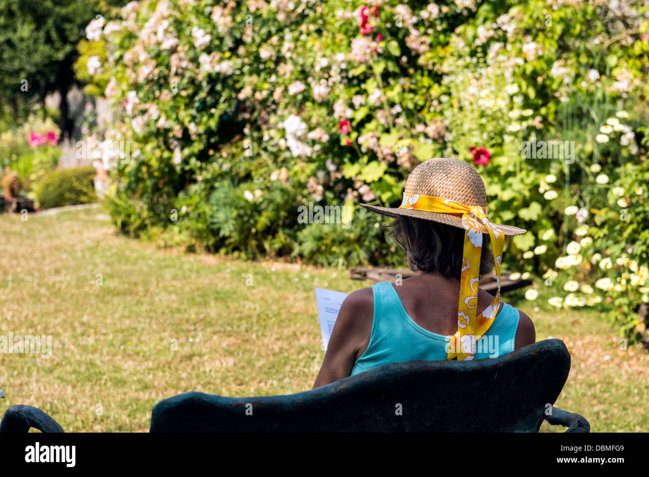 Woman reading L'Herbarium of Saint Valery sur Somme Picardie North France Europe - Stock Image