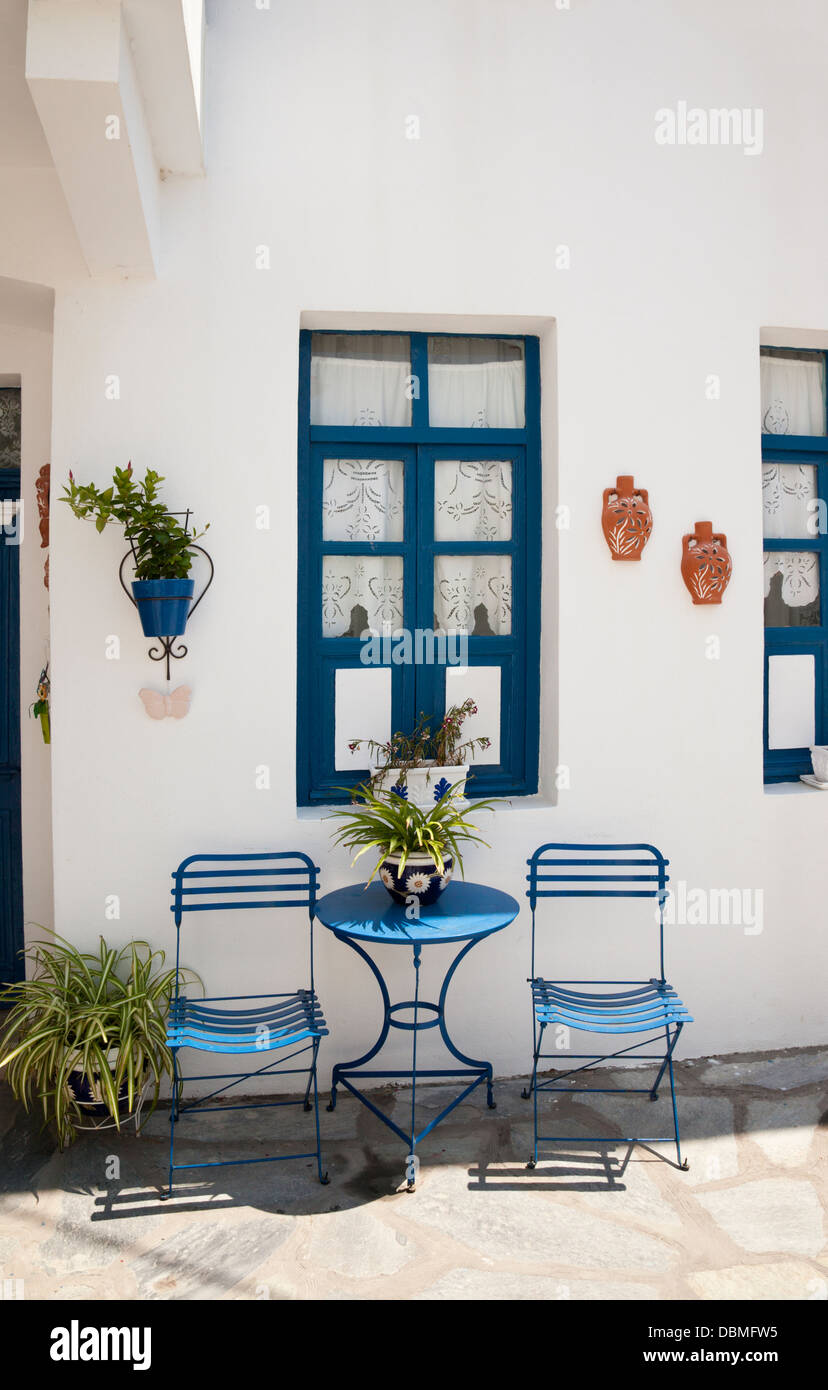 Blue table and chairs , Mandraki, Nisyros, Greece - Stock Image