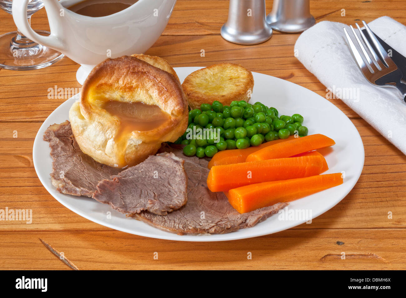 Roast Beef and Yorkshire Pudding - with gravy, roast potatoes, peas and carrots. - Stock Image