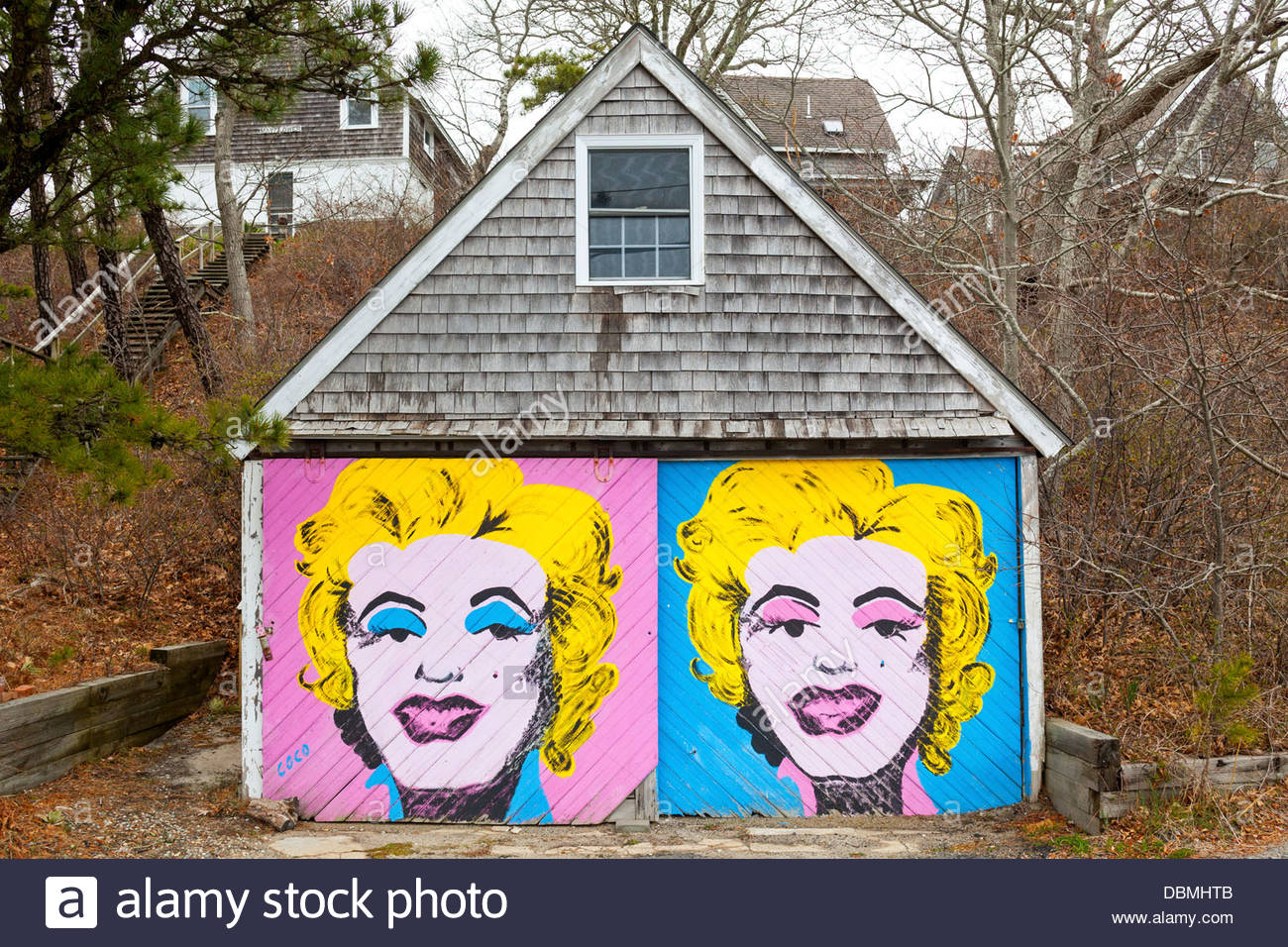 A car garage with a painting of Marilyn Monroe on it. - Stock Image