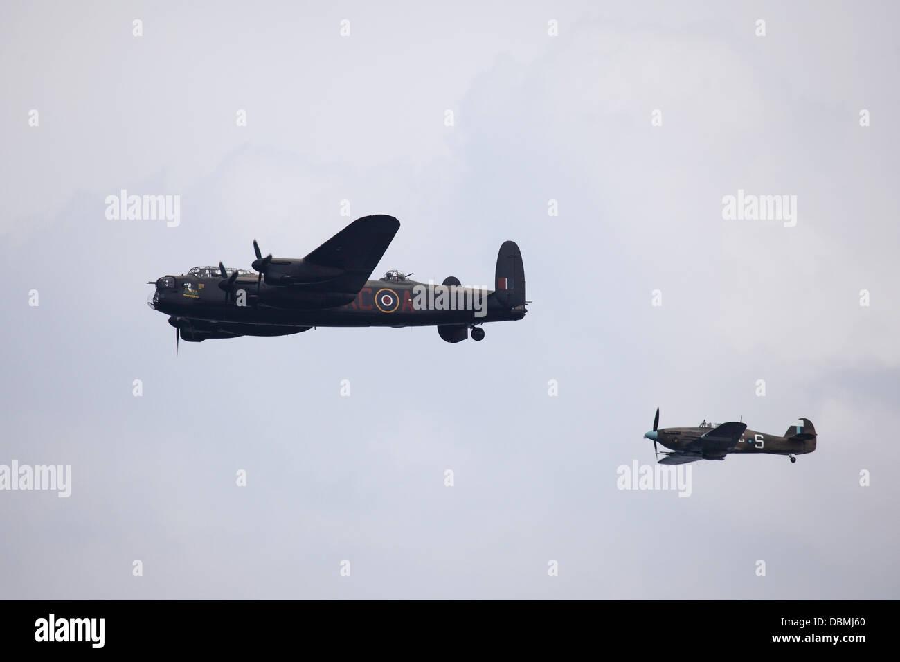 A Lancaster bomber and Hurricane fighter of the Battle of Britain Memorial Flight flying at Sunderland International - Stock Image