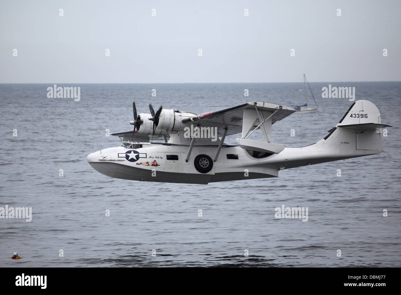 A US Army Airforce Consolidated PBY-5A Catalina flying at the 2013 Sunderland International Airshow. - Stock Image