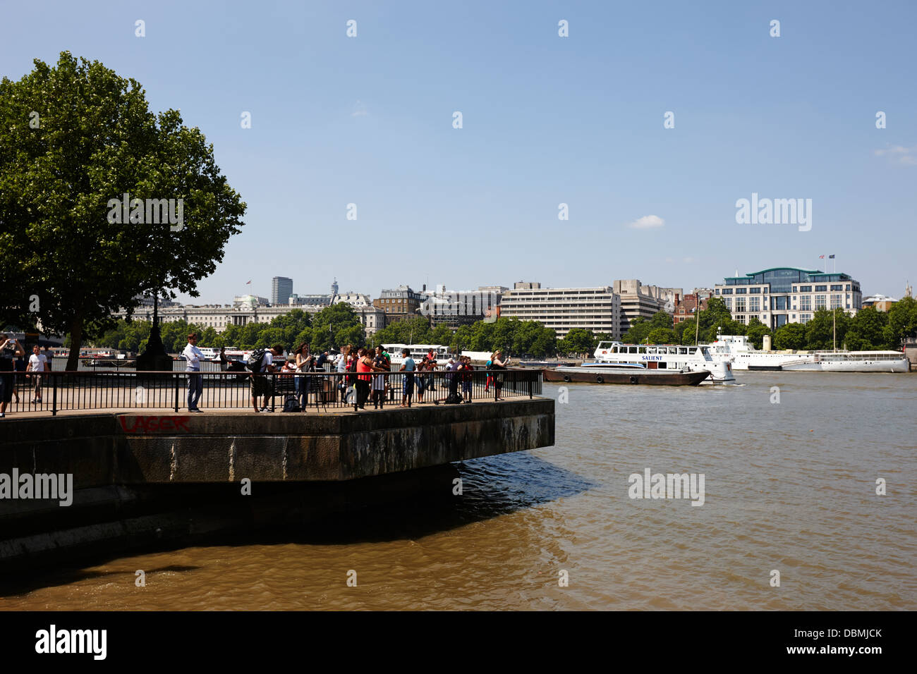 tourists at viewpoint on the south bank of the river thames London England UK - Stock Image