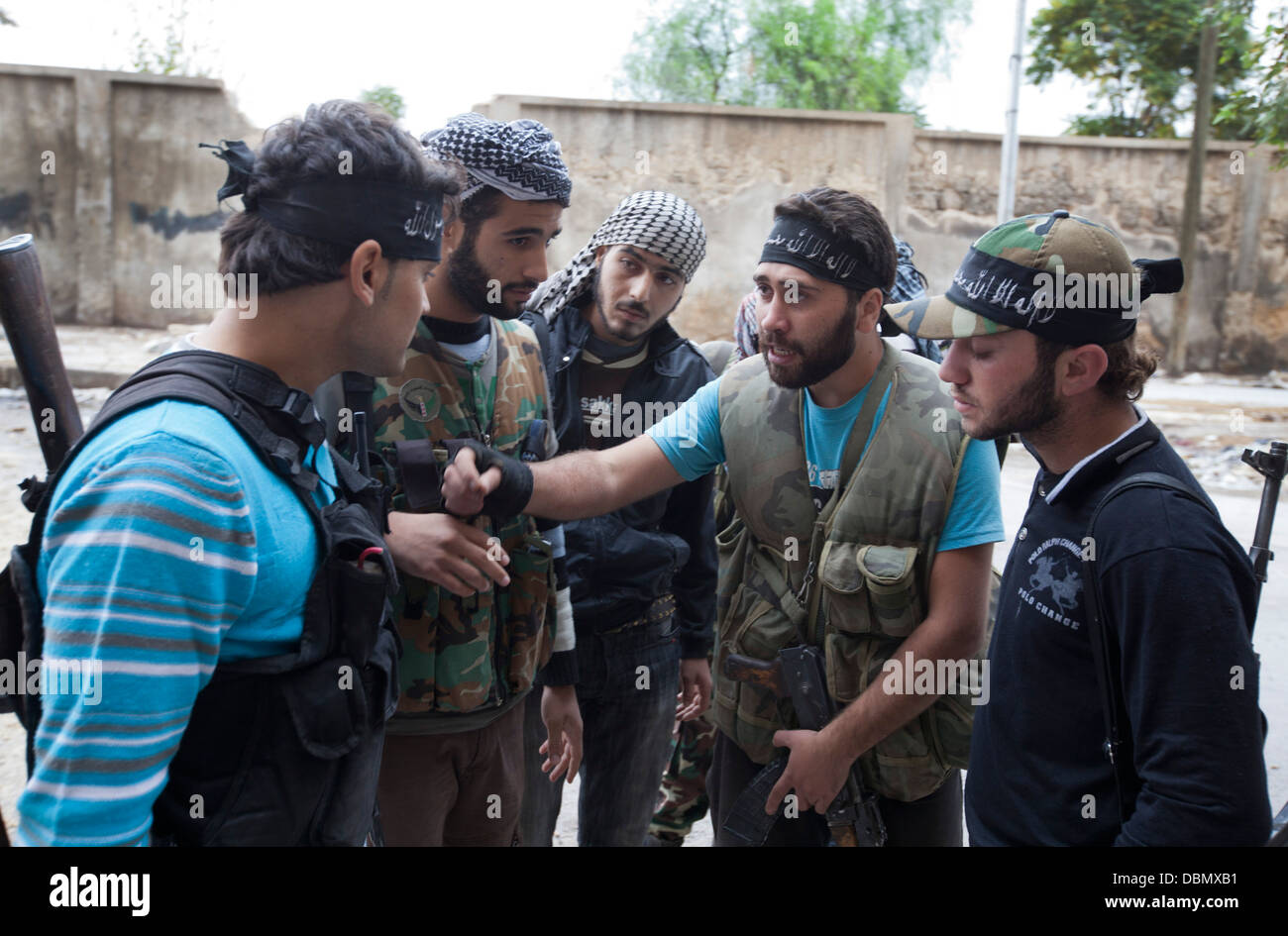 Free Syrian Army rebels speak before a mission in Aleppo, Syria. - Stock Image