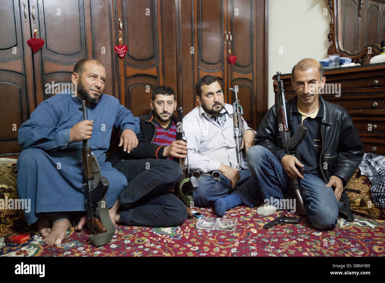 October 27, 2012 - Aleppo, Syria: Free Syrian Army fighters wait for a mission during the Eid Al Adah. - Stock Image