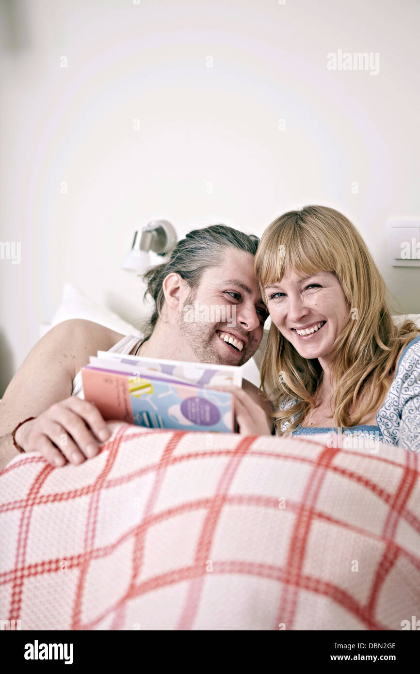 Couple In Bed - Stock Image