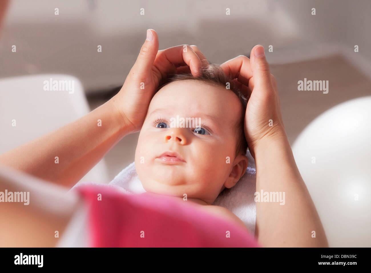 Baby boy receiving treatment from osteopath, Munich, Bavaria, Germany - Stock Image