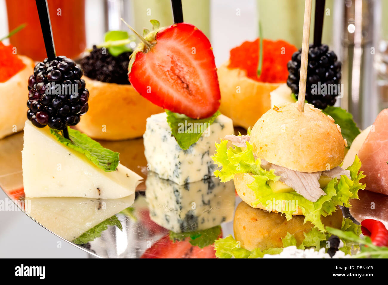 canape with meat vegetables and seafood - Stock Image