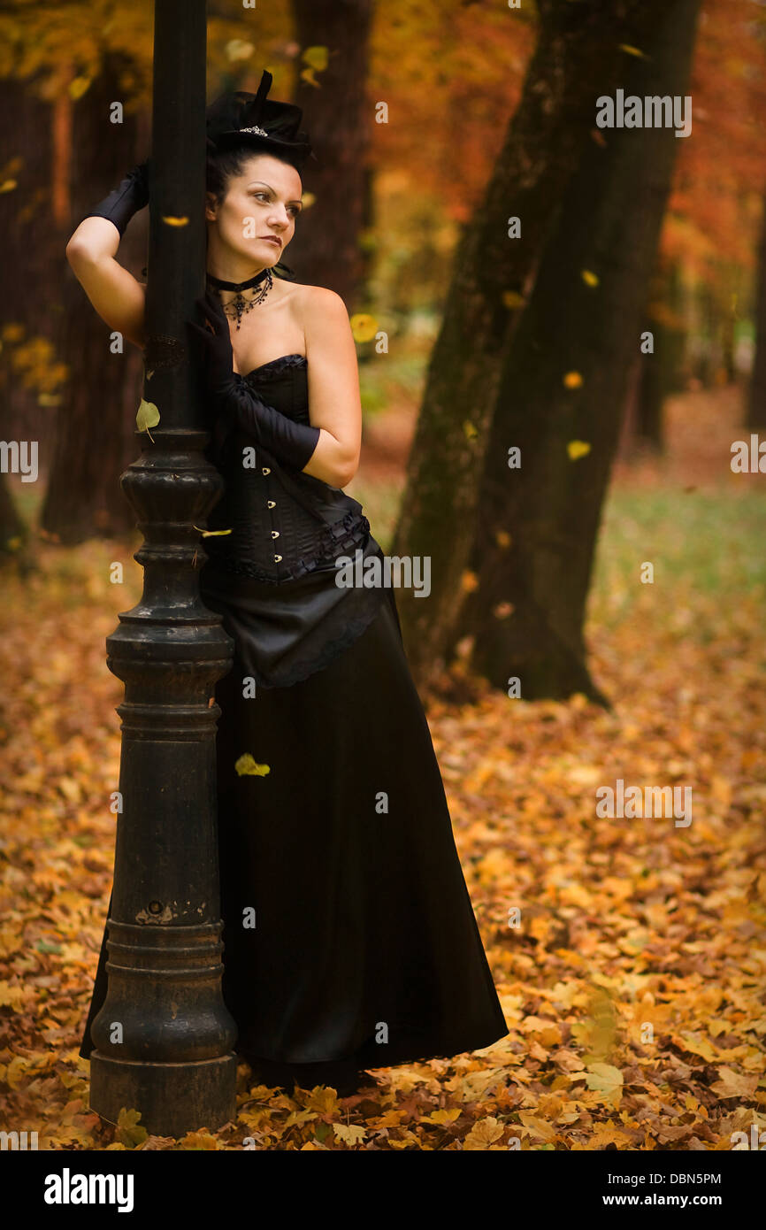 Young Woman In Gothic Style Fashion Leaning Against Lamp Croatia Europe