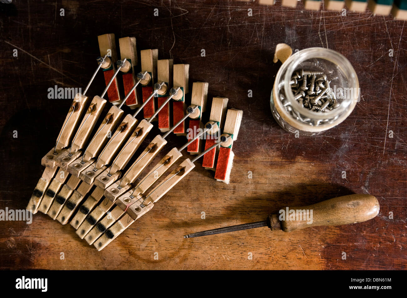 Musical mechanism of a piano alongside work tool, Regensburg, Bavaria, Germany - Stock Image