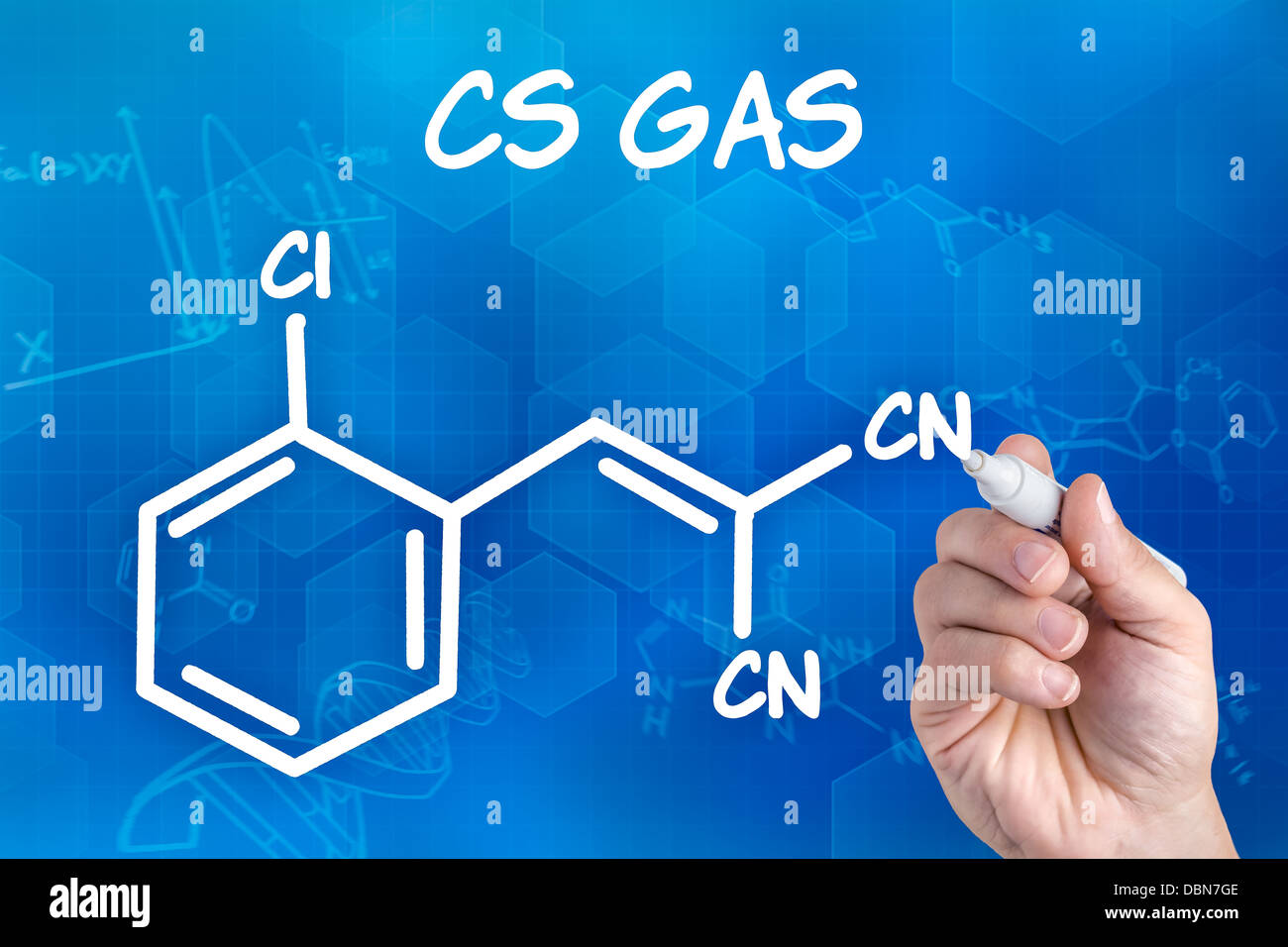 hand with pen drawing the chemical formula of CS Gas - Stock Image