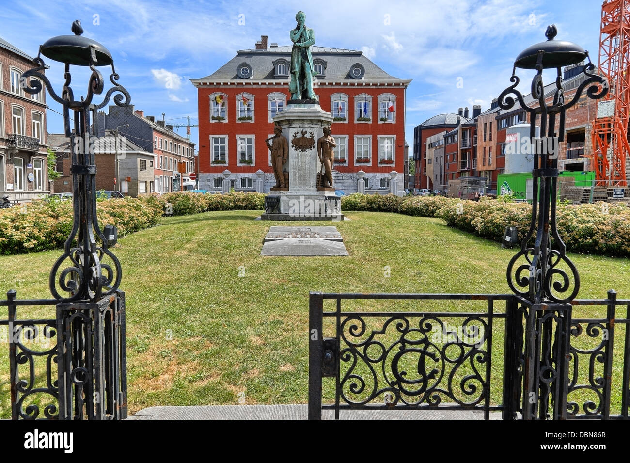 View of the Seraing city hall, a town in the south of Belgium. The statue at the foreground is for John cockerill. - Stock Image