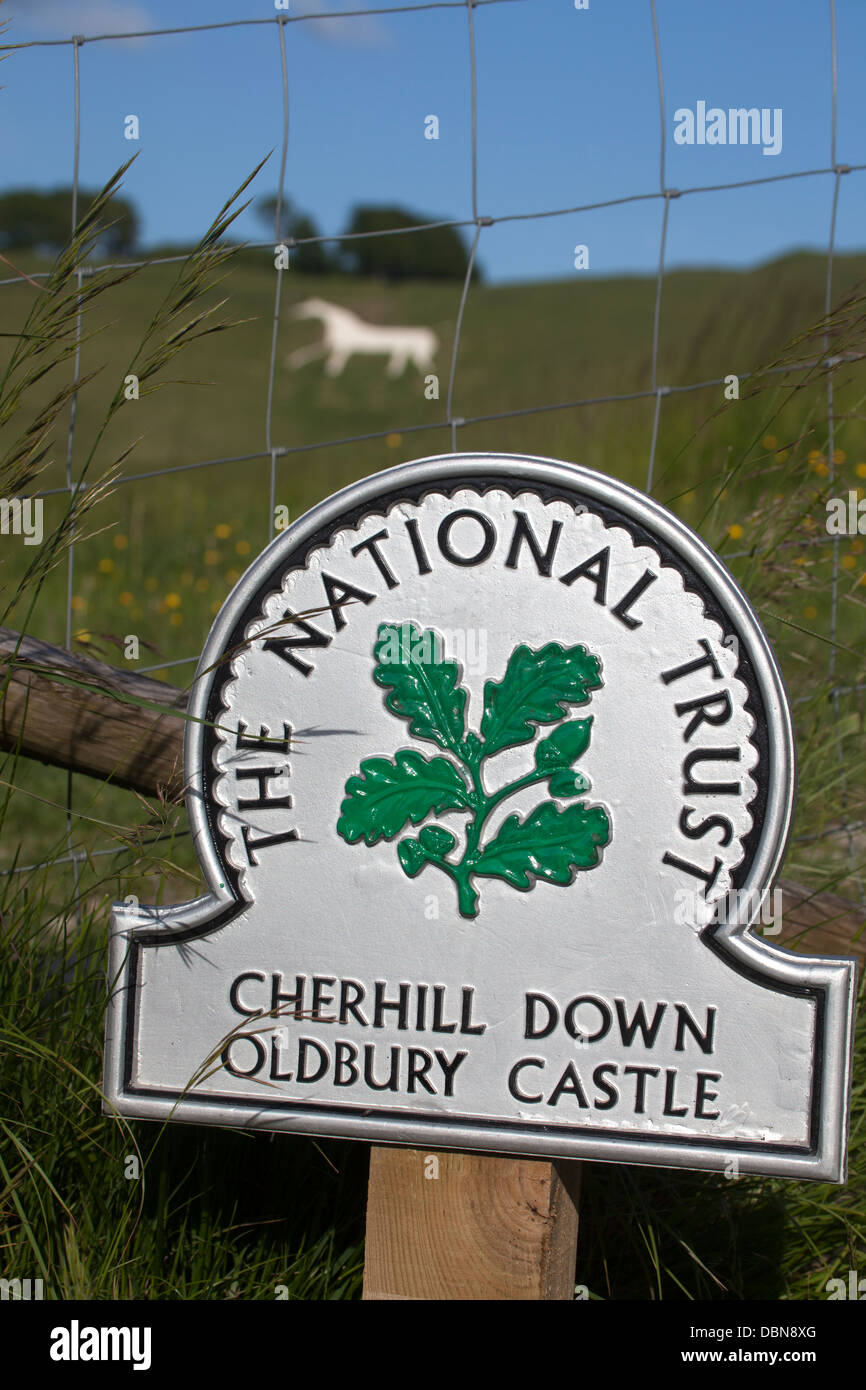 National Trust Sign at Cherhill Down Oldbury Castle with White Horse in Background Stock Photo